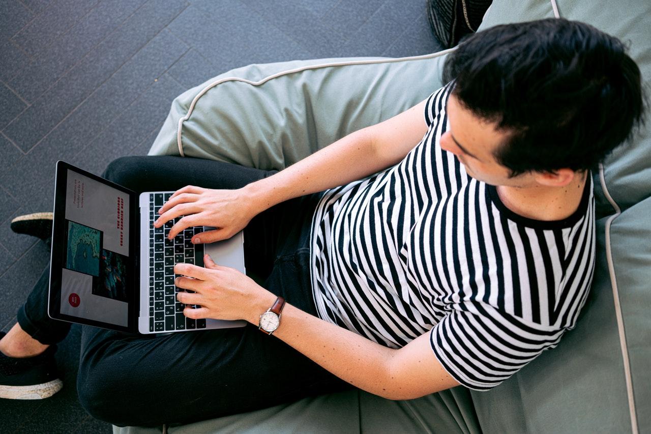 Photo Of Man Using Laptop 3194523