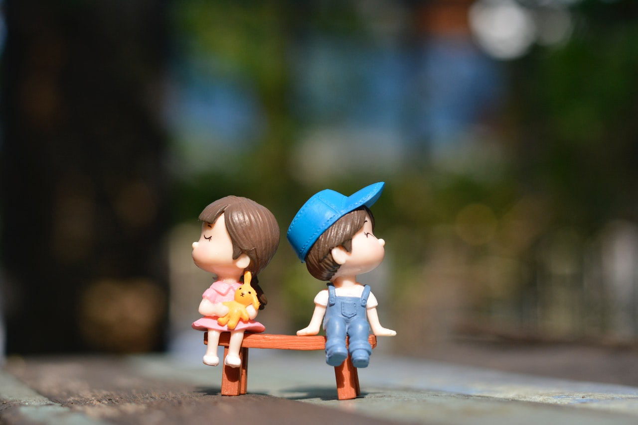 Boy And Girl Sitting On Bench Toy 1767434