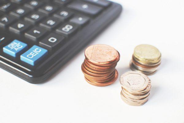 coins next to a calculator