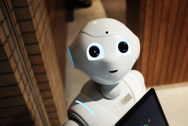 robot holding ipad